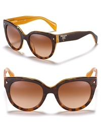 Invest in the forever sunglass like these round wayfarer shades from Prada.