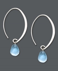 Let delicate blue hues frame your face. These subtly sweeping hoop earrings feature briolette drops of blue topaz (4 ct. t.w.) for a light splash of color. Set in 14k white gold. Approximate drop: 1-1/2 inches.