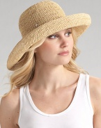 Packable wide brim style is hand-crocheted of natural raffia with an adjustable sizing cord. About 4 brim One size fits most Imported
